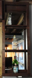 Bar cabinets and wine rack built out of circa 1930 recycled doors and old license plates for bar top