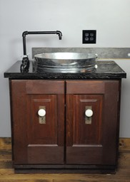 Bar sink built out of circa 1930 recycled doors, black pipe and a gavlanized bucket for sink
